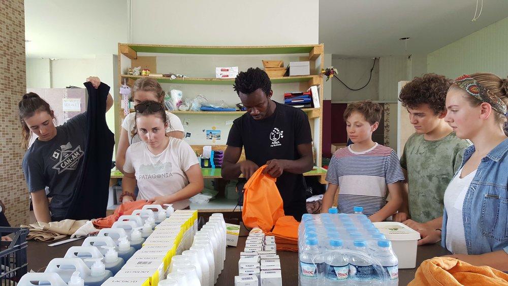 Packing boxes at the Attika warehouse. (Photo: Sarah Gley)