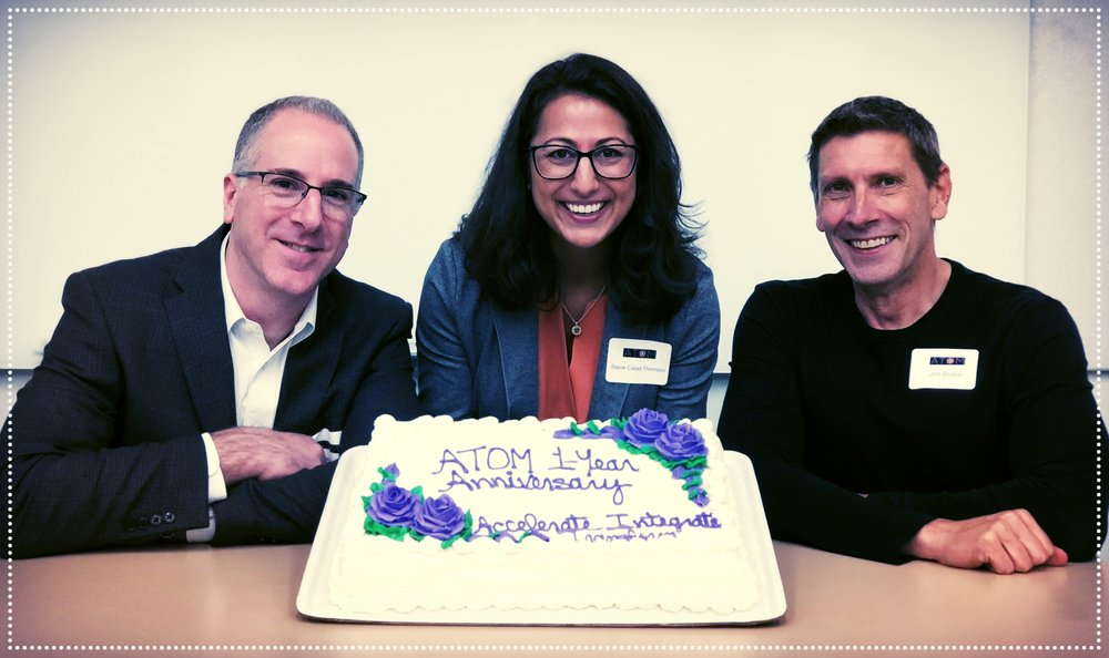 ATOM Co-leads  celebrating our one year anniversary. (L-R) Tom Rush, Ph.D., ATOM Head of Science; Stacie Calad-Thomson, Ph.D., ATOM Head of Operations; Jim Brase. M.S., ATOM Head of Technology.