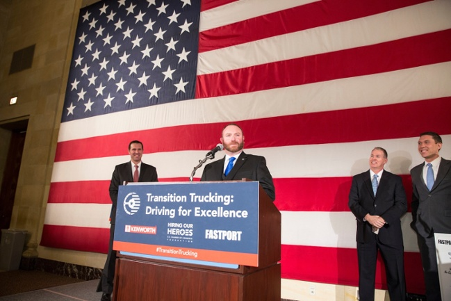 Transition Trucking: Driving for Excellence Award Winner Troy Davidson addresses audience at the U.S. Chamber of Commerce's Hall of Flags. (Left to Right) Hiring Our Heroes President Eric Eversole, FASTPORT President Brad Bentley, and Kenworth Marketing Director Kurt Swihart look on.