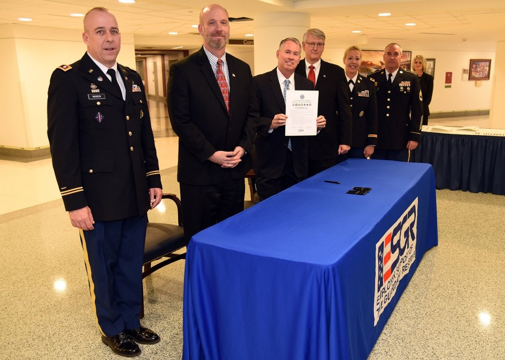 FASTPORT President Brad Bentley poses with ESGR and DOD staff after signing the Statement of Support.
