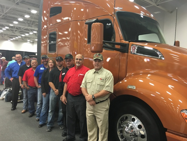 Top 10 Finalists for the Transition Trucking Award in front of a fully-loaded Kenworth T680, the same model they were nominated to win. From left to right: Brandon Douglas, Kevin Scott, Eli Tollinchi, Troy Davidson, Robyn Hyde, Jonathan Perez, Russell Hardy, Steven Cassaday, and Edward Cavanagh (not pictured: Christopher Scott).