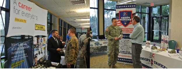 Left to right: J.B. Hunt and Quality Carriers representatives educating Soldiers on how their military experience prepares them for careers in the trucking industry