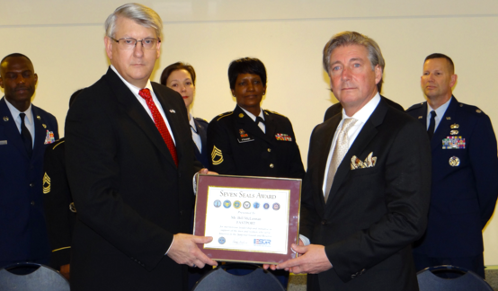 Alex Baird, ESGR Executive Director (left) presents Bill McLennan, FASTPORT CEO (right) with Seven Seals Award. (Photo courtesy of ESGR Headquarters.)