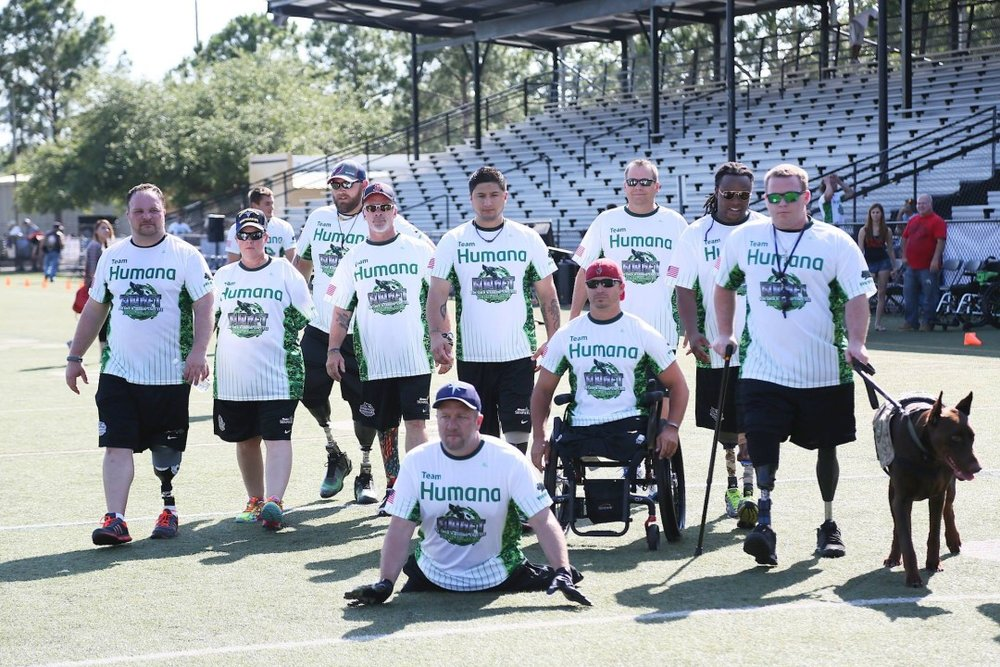 Members of the Wounded Warrior Amputee Football Team surveying the field before the charity football game begins where they defended their undefeated record.