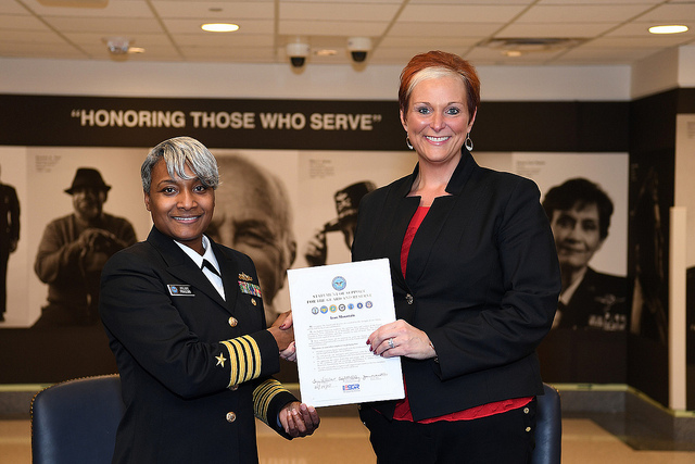 Executive Director, Employer Support of the Guard and Reserve Captain Juliet Perkins, United States Navy Reserve (left) and Tonja Wilhelms Senior Manager, Field Recruitment for Iron Mountain (right) displaying signed Statement of Support