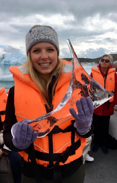 Here I am holding a piece of glacier (spoiler alert: it feels like plain old ice!)