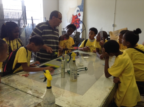 Ron Bechet,   Victor H. Labat Endowed Professor of Art at Xavier University of Louisiana, with students in the Kuumba Institute.