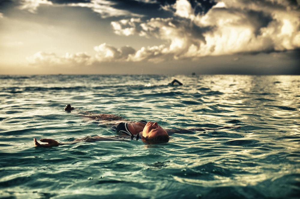 A woman floats in the ocean in the Dominican Republic.  Image by New Orleans based travel photographer, Marc Pagani