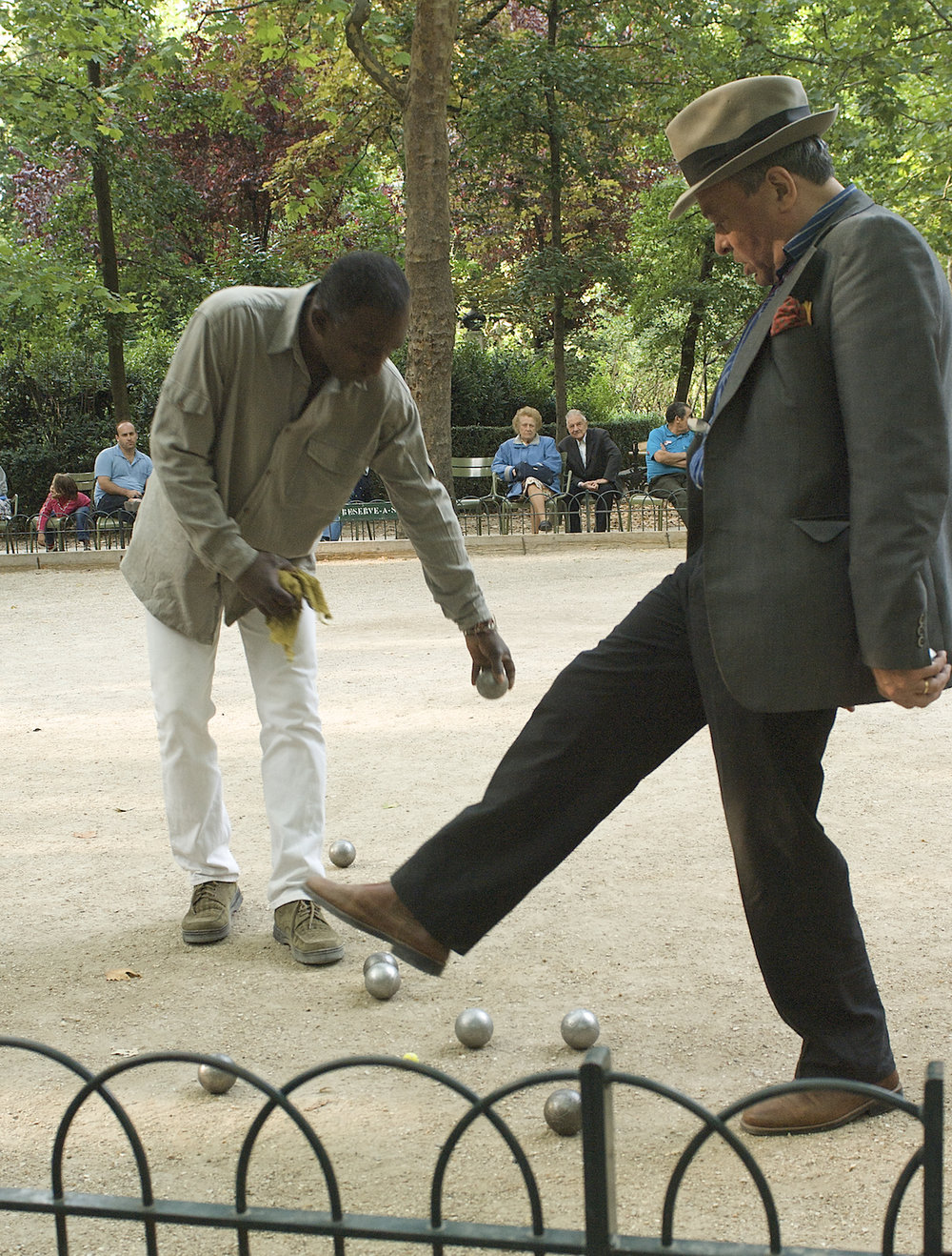 Men play petanque in Luxembourg Garden in Paris. Image by New Orleans based travel photographer, Marc Pagani - marcpagani.com.