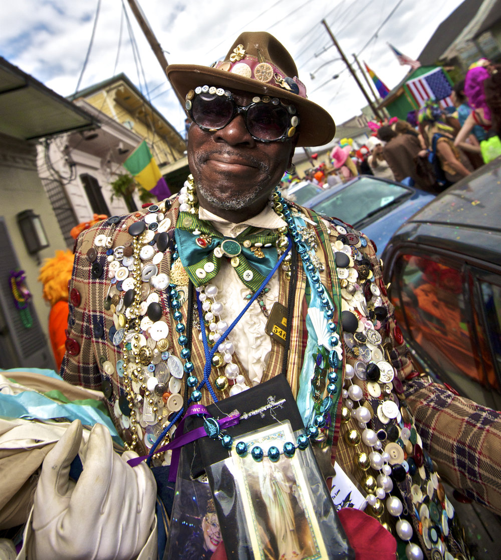 Button Man on Mardi Gras Day in New Orleans. A Mardi Gras Indian in New Orleans.  Image by New Orleans based travel photographer, Marc Pagani - marcpagani.com