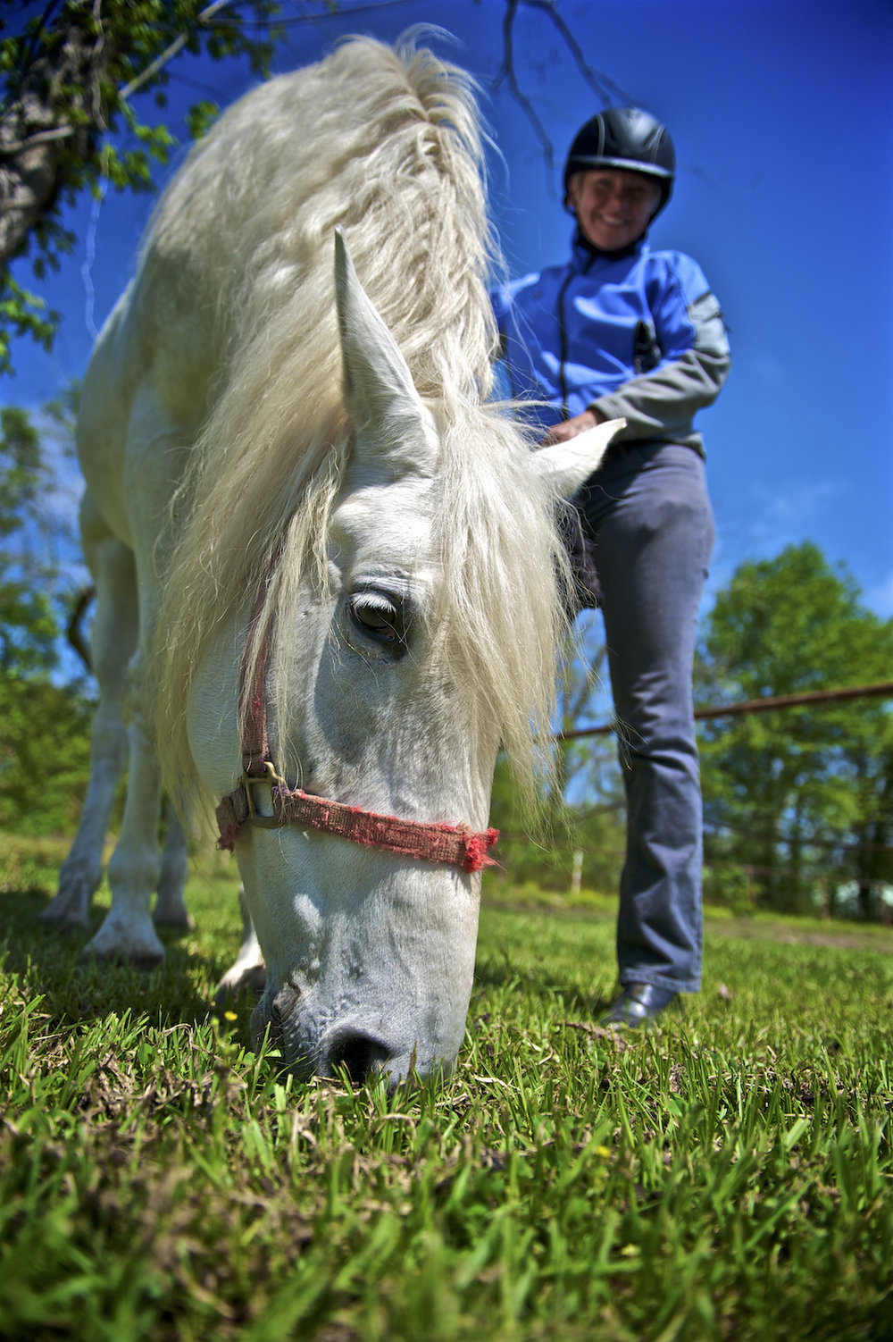 A woman poses with her horse on the Westbank of New Orleans.   Photographed by New Orleans based photographer, Marc Pagani