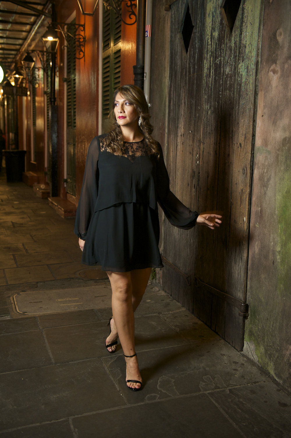 Julizza in front of Preservation Hall in the French Quarter of New Orleans, photographed by New Orleans based photographer, Marc Pagani