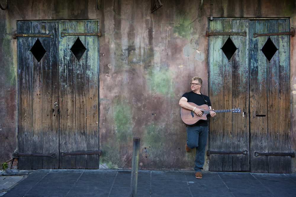 Taylor in front of Preservation Hall in the French Quarter of New Orleans,  by New Orleans based photographer, Marc Pagani