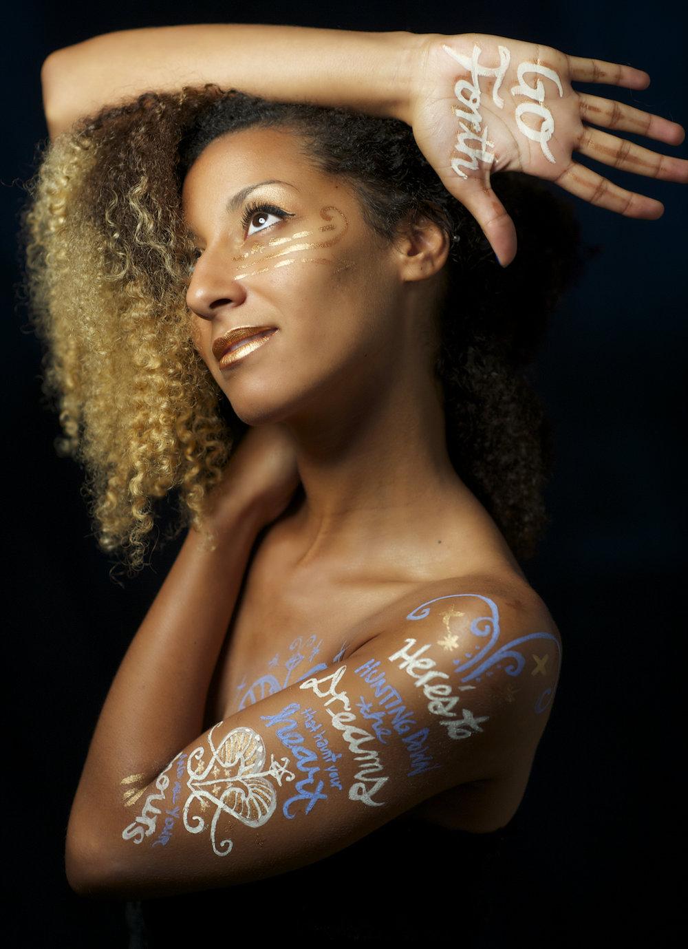 A studio portrait headshot of Nasimiyu.  Image by New Orleans based portrait photographer, Marc Pagani