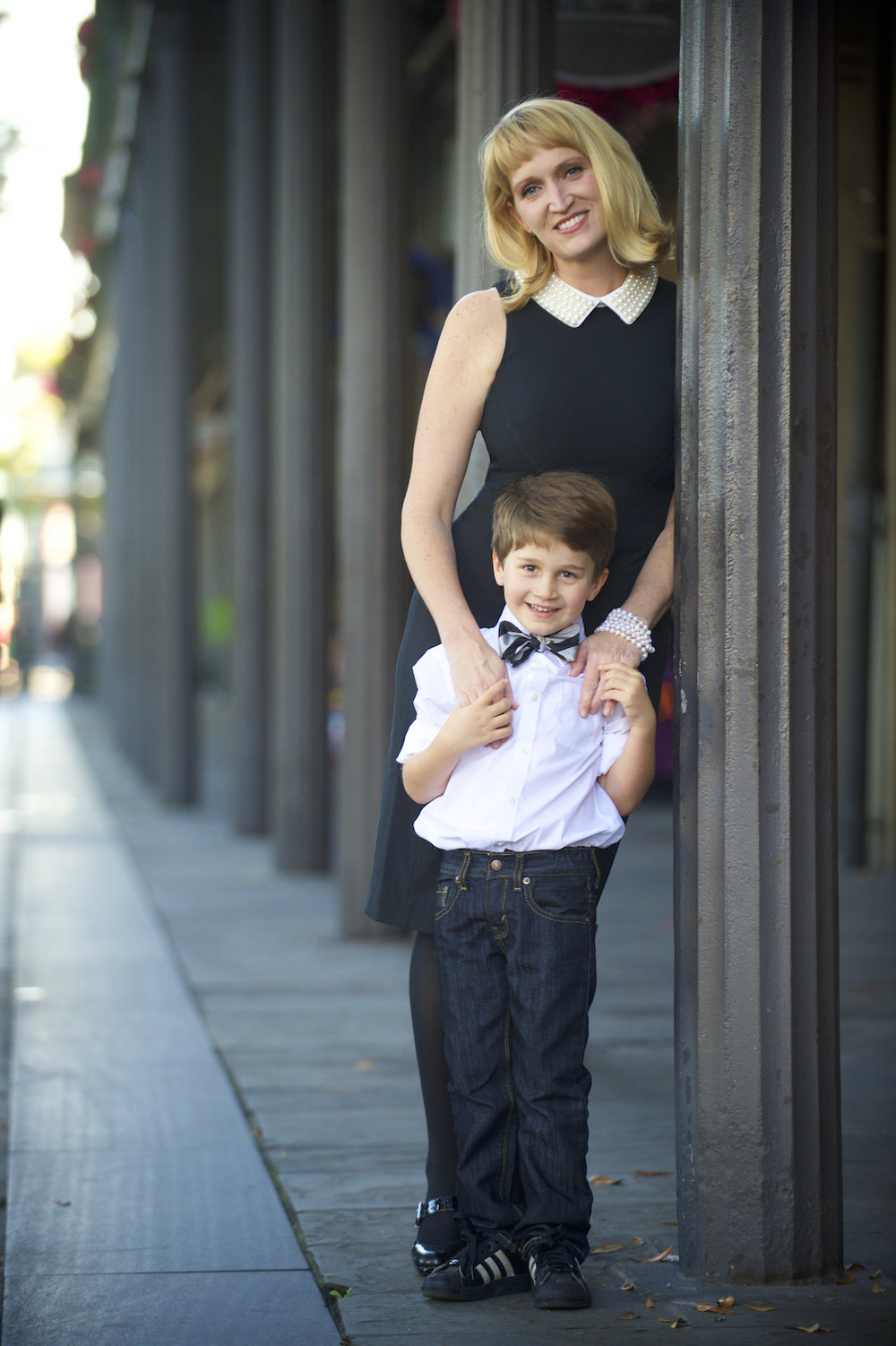 A mother with her son in the French Quarter of New Orleans.  Photo by New Orleans based photographer, Marc Pagani