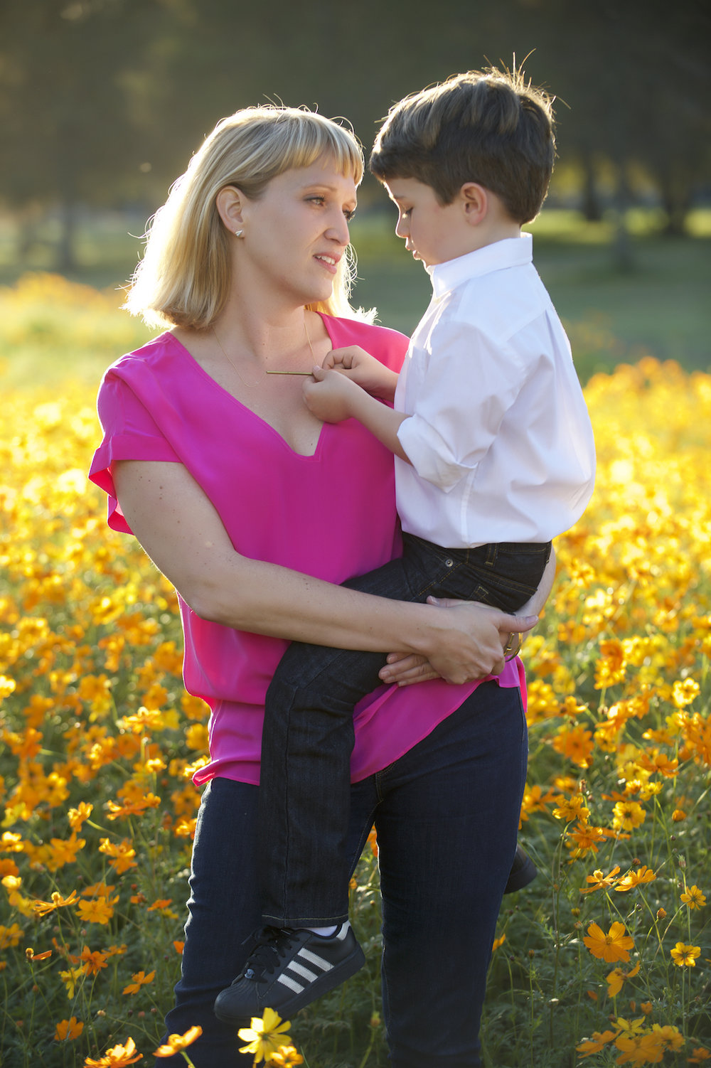 A mother and her young son in a filed of flowers.  Photo by New Orleans based photographer, Marc Pagani