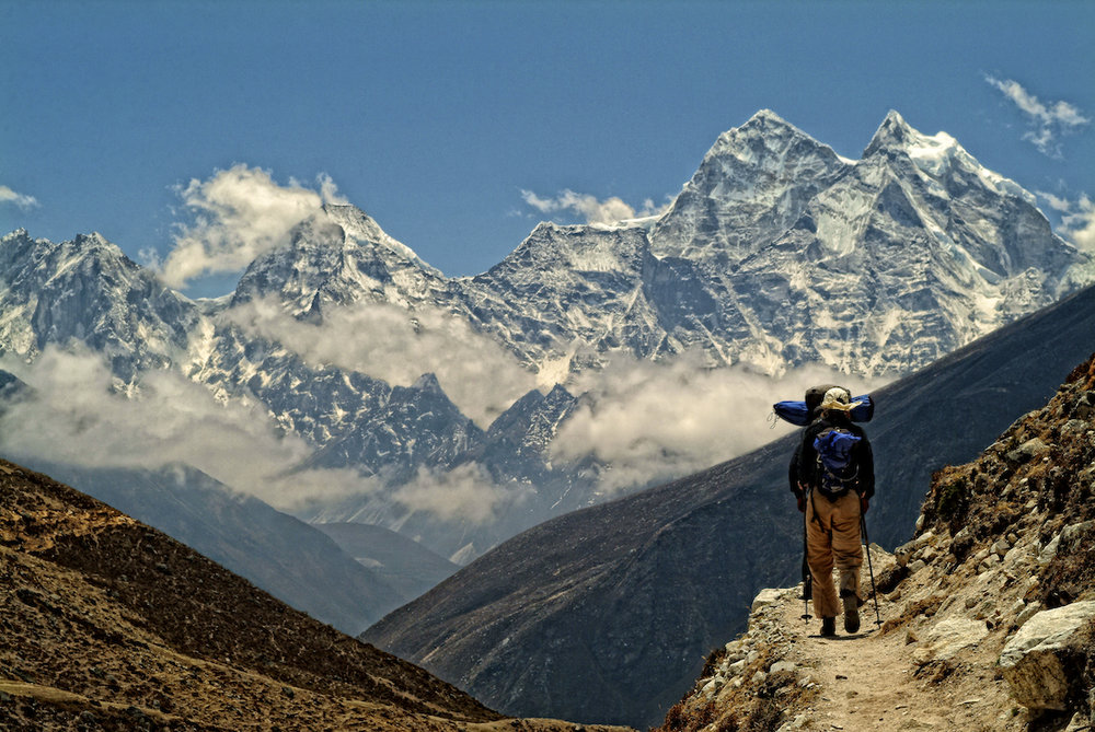 trekkers make their way towards Mount Everest base camp in the Nepal Himalayas.  Image by New Orleans based travel photographer, Marc Pagani - marcpagani.com