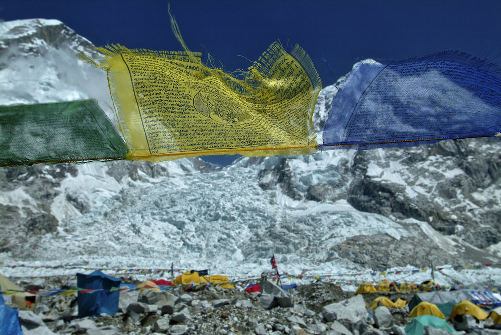 Buddhist prayer flags at Mount Everest base camp in the Nepal Himalayas.  Image by New Orleans based travel photographer, Marc Pagani
