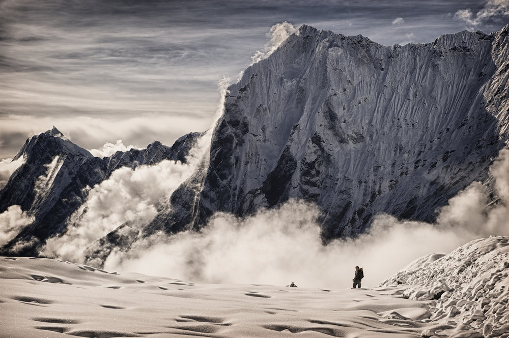 A climber near the Khunde Ridge in the Nepal Himalayas.  Image by New Orleans based travel photographer, Marc Pagani