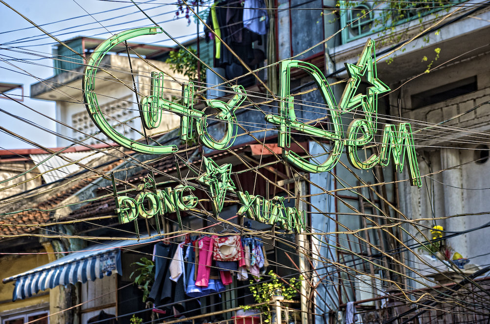 Street signs and powerlines in Hanoi Vietnam.  Image by New Orleans based travel photographer, Marc Pagani - marcpagani.com.