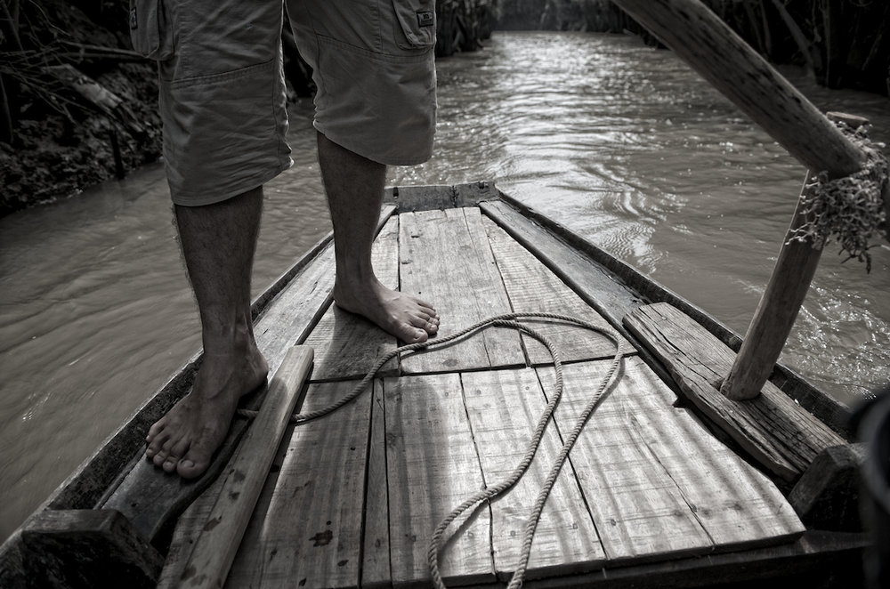 a boatman on the Mekong River in Ho Chi Minh City, Vietnam.  Image by New Orleans based travel photographer, Marc Pagani - marcpagani.com
