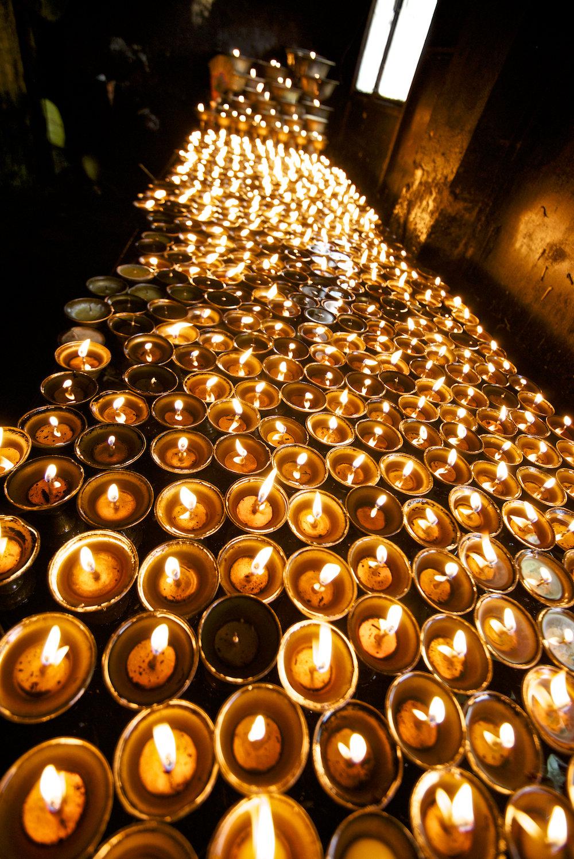 Yak butter Buddhist prayer lamps at Swayambhunath Temple in Kathmandu, Nepal.  Image by New Orleans based travel photographer, Marc Pagani - marcpagani.com