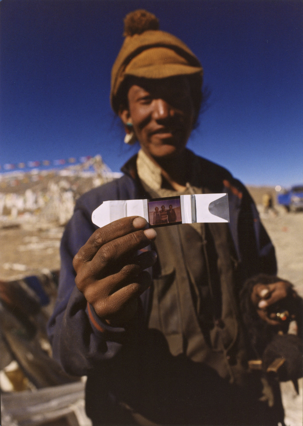A Tibetan yak herder sees a photograph of himself for the first time. Image by New Orleans based travel photographer, Marc Pagani - marcpagani.com