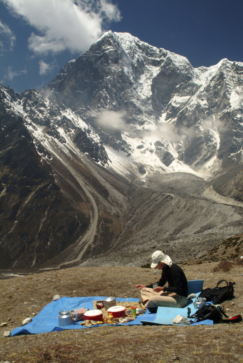a trekker enjoys lunch on the way to Mount Everest Base Camp in the Nepal Himalayas.  Image by New Orleans based travel photographer, Marc Pagani - marcpagani.com