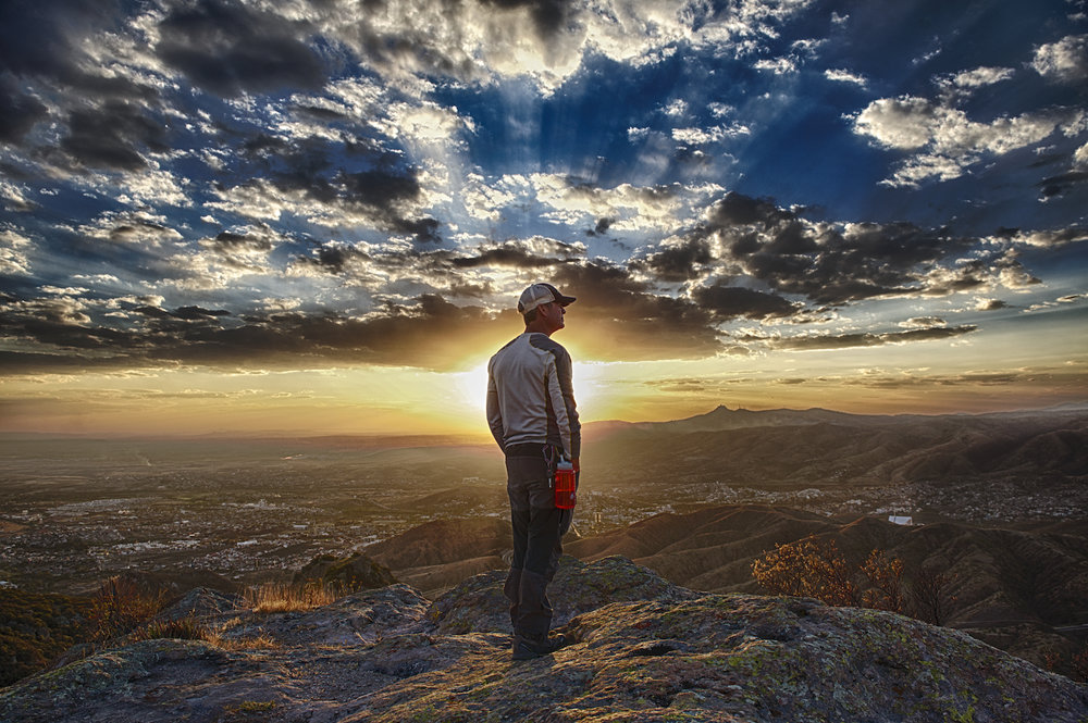 Tom MacDonald views the sunset above Guanajuato, Mexico. Image by New Orleans based travel photographer, Marc Pagani