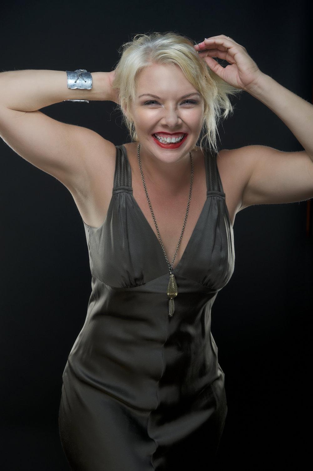 A studio portrait headshot of  Amanda Walker.  Image by New Orleans based portrait photographer, Marc Pagani