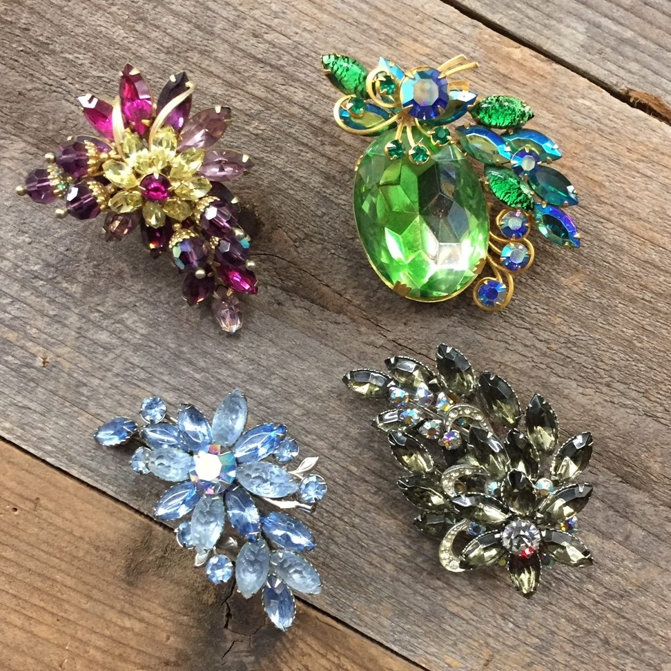 Rhinestone Brooches, $20 to $48