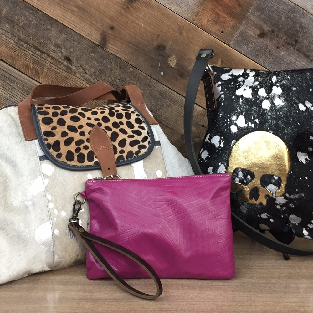 Multi-hide Weekender Bag, $395.  Gold Skull Cross-Body Feed Bag, $175.  Textured Leather Wristlet, $59.50