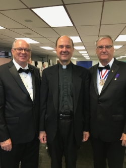 Rev. Fr. Tomas Nasta, the newly installed pastor of Sacred Heart, Swedesburg with Sir Knights Korpel and Kaemmer