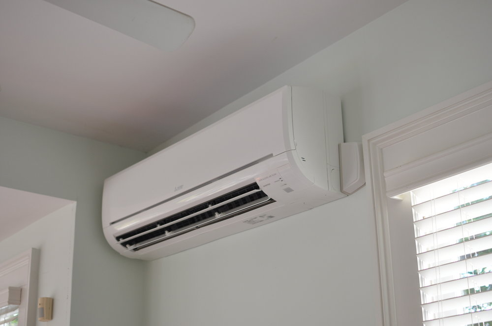 The smaller Mini Split unit sits close to the ceiling.