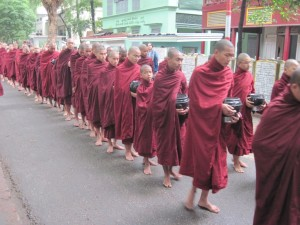 Mahagandhayan Monastery monks line up for lunch.