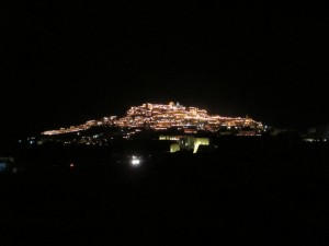 Pyrgos lit by Holy Friday flames