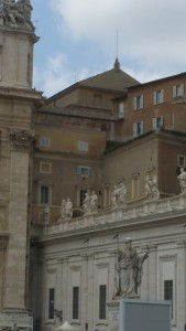 Sistine Chapel peaking over St Peters Square