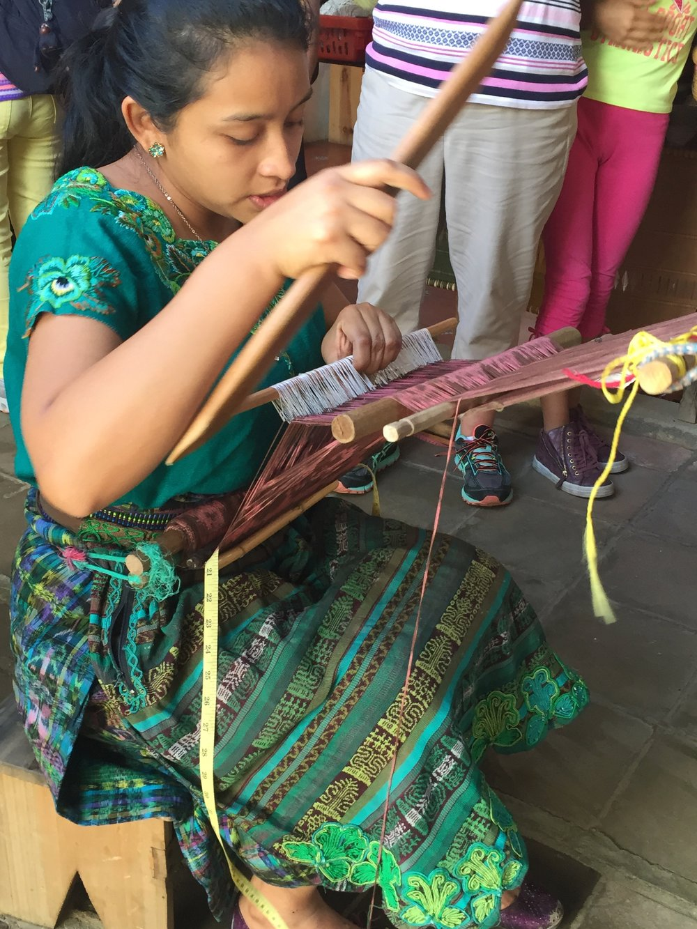 weaving demo at woman coop.jpg