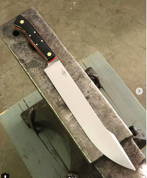 "This was a commission for a competition BBQ Chef who wanted a brisket slicer with a little bit of flair so we came up with a scimitar style brisket knife. The blade is 10"" and the knife is 14 1/4"" all day."