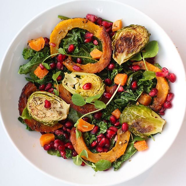"""Question: What's your favorite thing to put pomegranate seeds on? . Fall vibes are going strong in my household this week 🍁🍂#whatsonmyplate 👉🏻 a """"warm salad"""" of sautéed kale and spinach, pre-roasted Brussels/delicata squash/carrots + pom seeds + pea shoots + added pepitas after the picture.Topped with a vinaigrette of a little olive oil/white wine vinegar/splash of pure maple."""