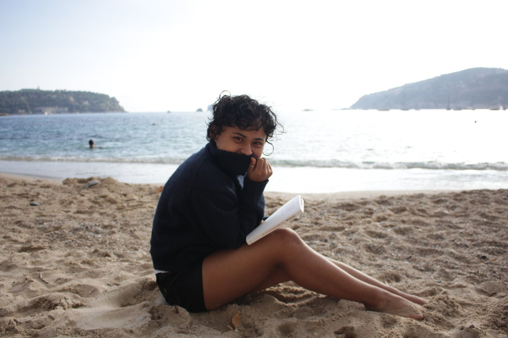Here's Edwina, sitting on the beach in the South of France, editing our book… well this isn't really our book. But, our book is coming out this week!