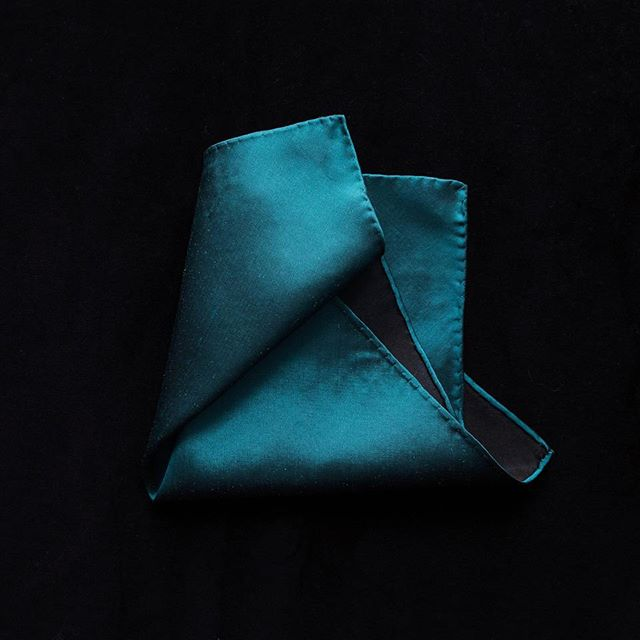 A beautifully stitch by stitch hand-rolled pocket square