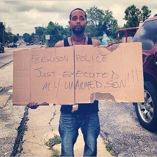 Mr. Louis Head: Ferguson Police Just Executed My Unarmed Son, Sign, 2014, used with permission of Mr. Head.