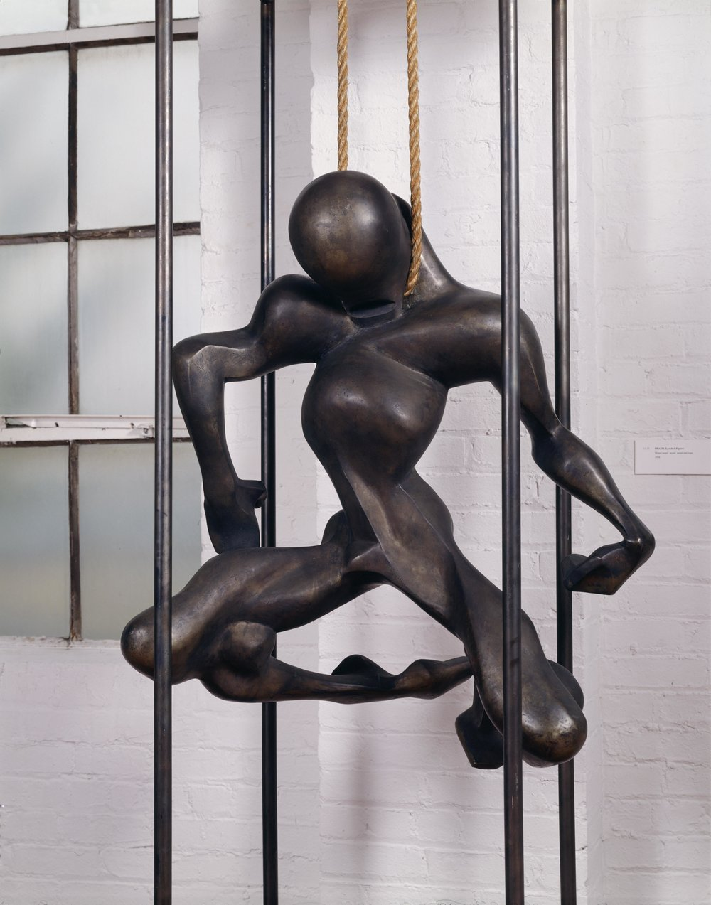 Death (Lynched Figure), 1934. Isamu Noguchi. Monel metal, steel, wood, rope. 88 3/4 x 31 7/8 x 22 1/8 in. Collection of The Isamu Noguchi Foundation and Garden Museum, New York. ©The Isamu Noguchi Foundation and Garden Museum, New York / Artist Rights Society [ARS]. Photo by Sara Wells.   Reproduction, including downloading of Isamu Noguchi works is prohibited by copyright laws and international conventions without the express written permission of Artists Rights Society (ARS), New York.