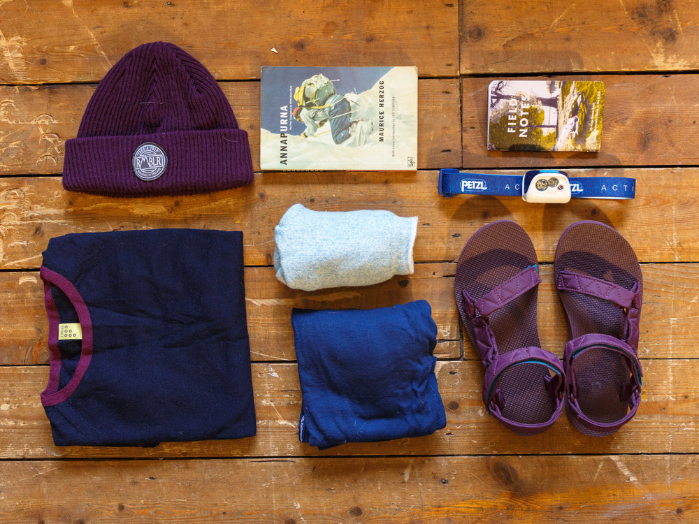 Left to right: RMBLR SHINING beanie,  Annapurna  by Maurice HerzoG, Field Notes notepad, Findra Merino base-layer, RMBLR SOCKS KATHMANDU LEGGINGS, PETZL ACTIK HEAD-TORCH, TEVA SANDALS.