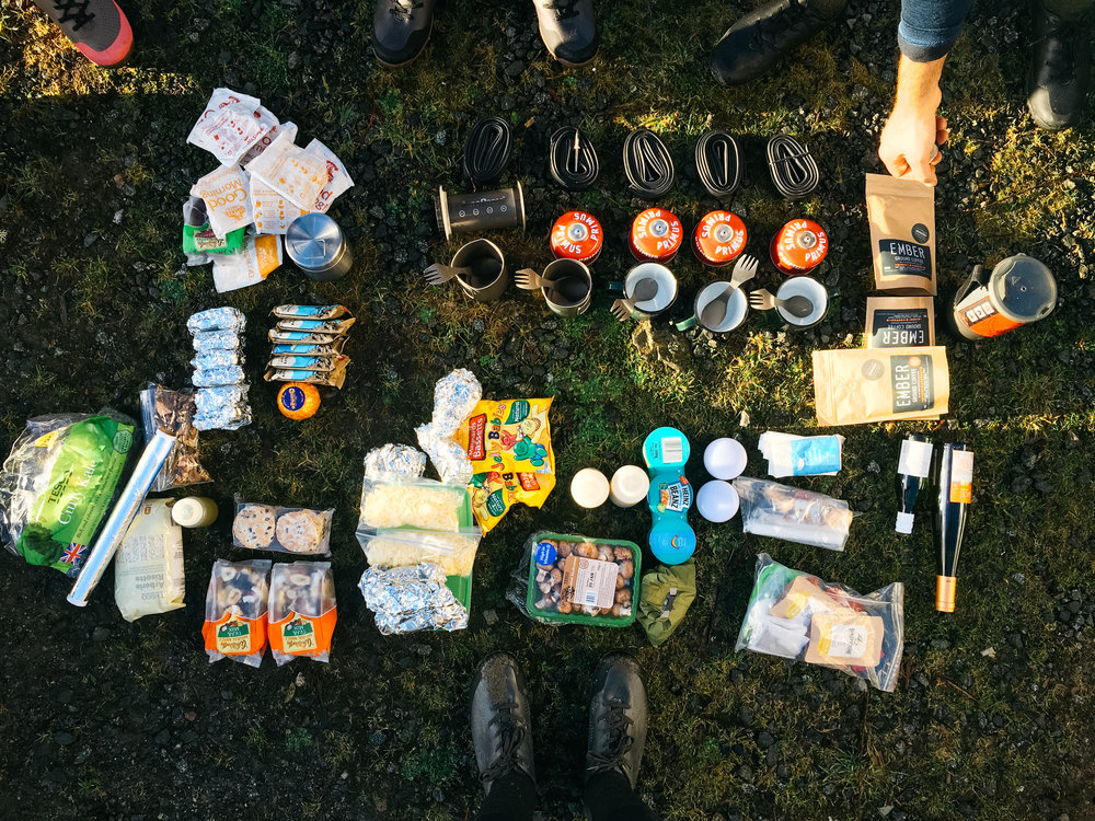 Distributing supplies into our bikepacking bags