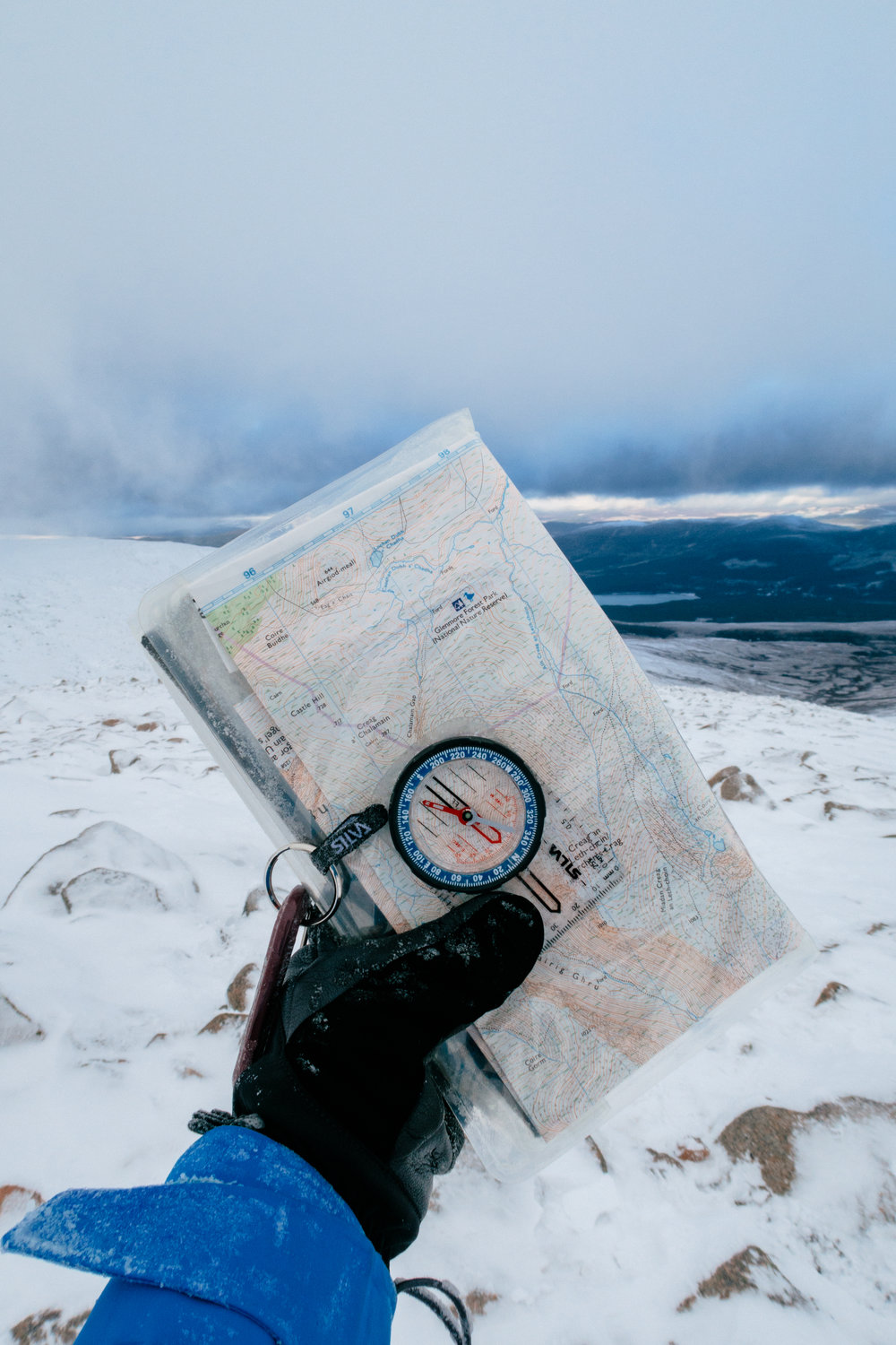os map and silva compass in the mountains