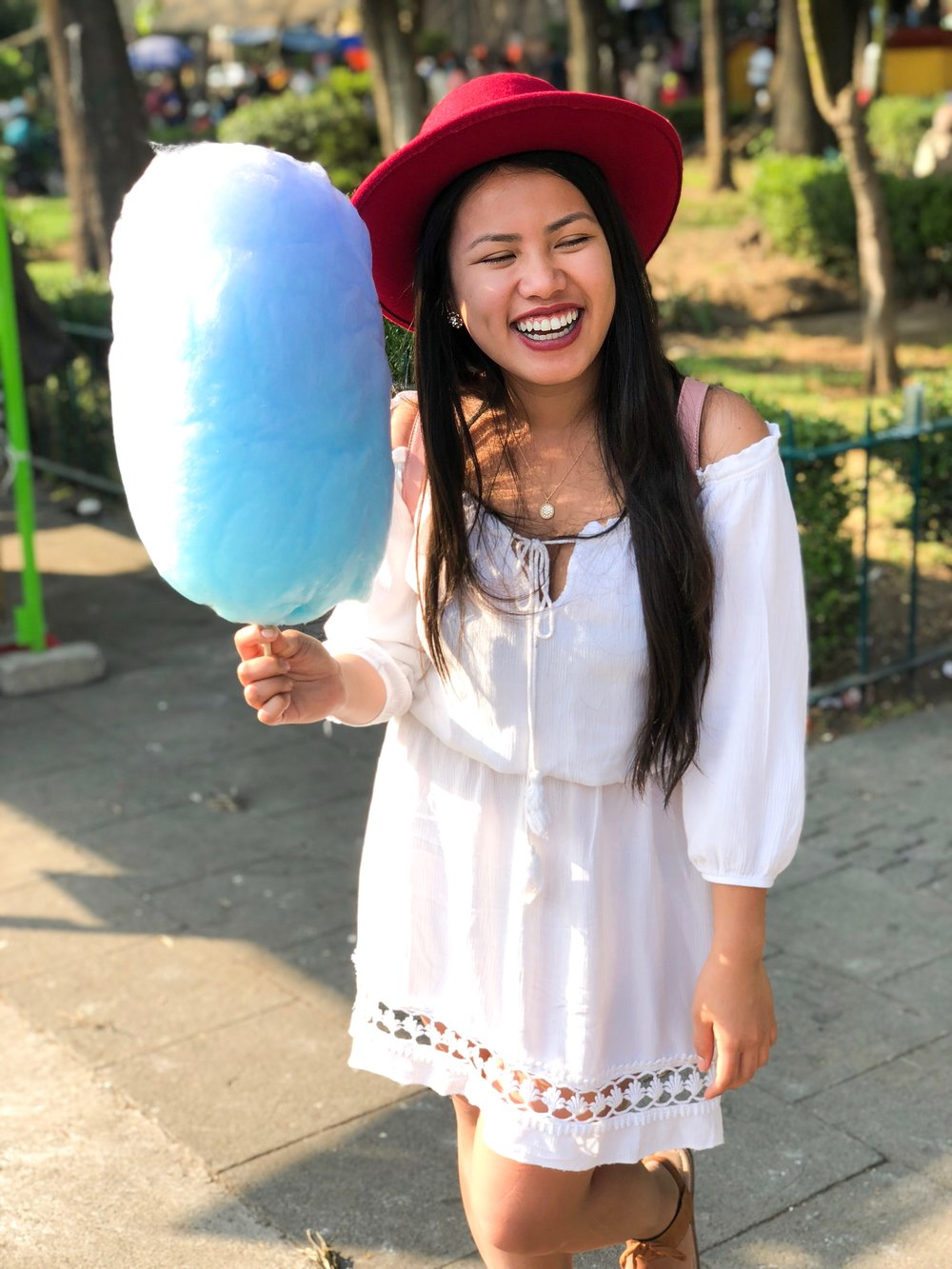 11 peso ($0.60 USD) cotton candy?  Who wouldn't be all smiles!