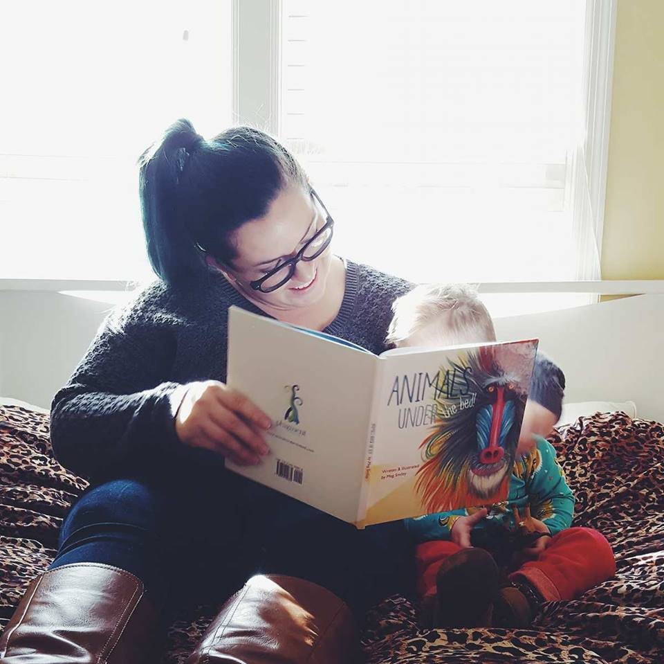 "Mom Blogger Ayana Nell of ""Little Prince Leopold"" reading the book to her son (Photo Credit: Ayana Nell)"