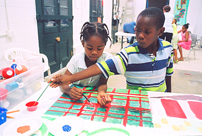 Two youngsters collaborate on a painting at The Porch's summer art camp- photo by Stephen Smith